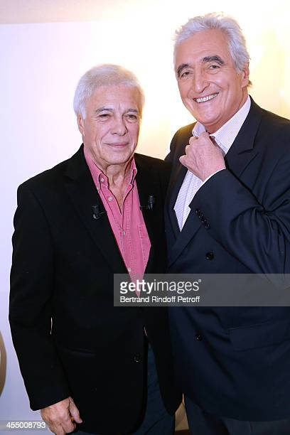 Humorist Guy Bedos with JeanLoup Dabadie attend 'Vivement Dimanche' French TV Show at Pavillon Gabriel on December 10 2013 in Paris France