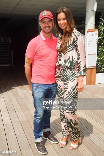 Humorist Jarry and Miss France 2010 Malika Menard attends the 2018 French Open Day Eight at Roland Garros on June 3 2018 in Paris France