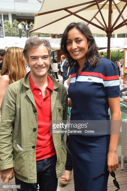Humorist Jonathan Lambert and journalist Leila Kaddour attend the 2018 French Open Day Four at Roland Garros on May 30 2018 in Paris France