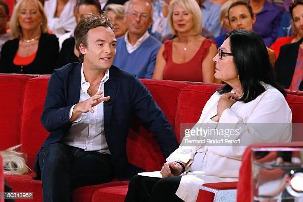 Humorist Jonathan Lambert and singer Nana Mouskouri attend 'Vivement Dimanche' French TV Show at Pavillon Gabriel on September 11 2013 in Paris France