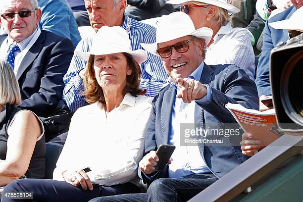 Humorist Michel Leeb and his wife Beatrice attend the 2015 Roland Garros French Tennis Open Day Nine on June 1 2015 in Paris France