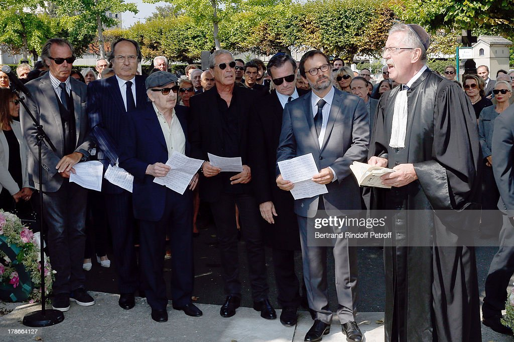 Humorist Michel Leeb, guest, humorist Popeck, Jean Claude Darmon, actor Francis Huster, son of Pierre Huth, director James Huth and Rabby pray at President of FIFA protocol Doctor Pierre Huth's Funeral in Nogent Sur Marne cemetery on August 30, 2013 in Nogent-sur-Marne, France.