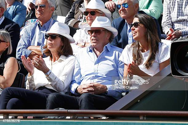 Humorist Michel Leeb sitting between his wife Beatrice and their daughter Elsa attend the 2015 Roland Garros French Tennis Open Day Nine on June 1...