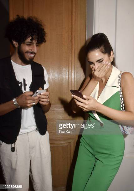 Humorist Mr Nouar and Farnoush Hamidian attend Mauboussin Private Party Hosted by Select vu First Production At Villa Rue Pierre Guerin on July 09...