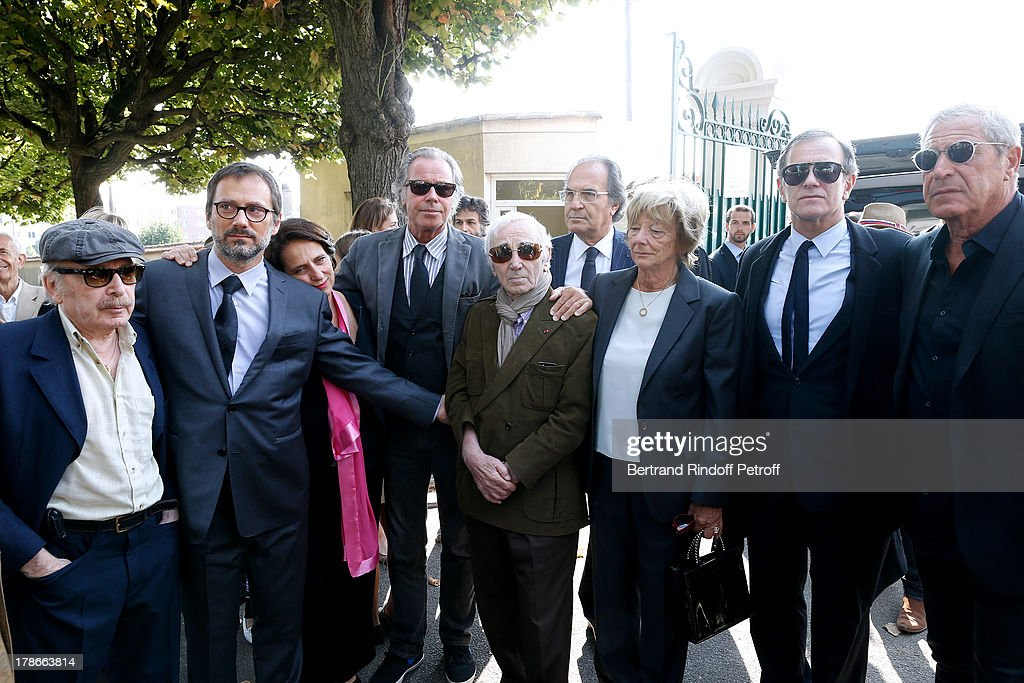 Humorist Popeck, children of Pierre Huth, director James Huth and Nathalie Huth-Guizol, humorist Michel Leeb, singer Charles Aznavour, friend of Pierre, wife of Pierre Huth, Doctor Francoise Huth, actor Francis Huster and Jean-Claude Darmon attend President of FIFA protocol Doctor Pierre Huth Funeral in Nogent Sur Marne cemetery on August 30, 2013 in Nogent-sur-Marne, France.