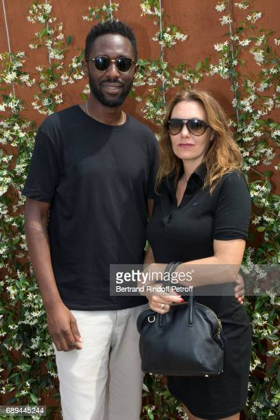 Humorist Thomas N'Gijol and actress Karole Rocher attend the 2017 French Tennis Open Day One at Roland Garros on May 28 2017 in Paris France