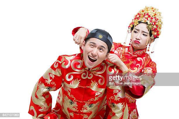 Humorous bride and groom
