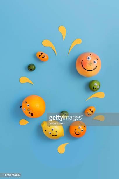 humorous citrus fruits conceptual image. - símbolo conceitual - fotografias e filmes do acervo