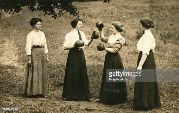 Humorous vintage photograph of women boxing in long skirts c 1915 Toned silver print
