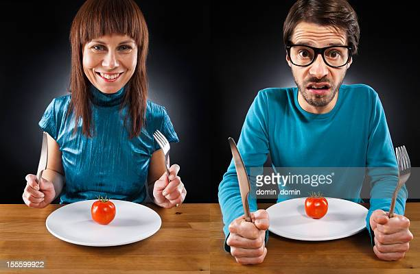 Humorously, Man, woman on vegetables diet, cherry tomato on plate