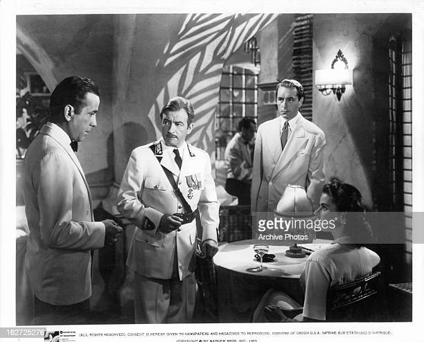 Humphrey Bogart addresses Claude Rains Paul Henreid and Ingrid Bergman in a scene from the film 'Casablanca' 1942
