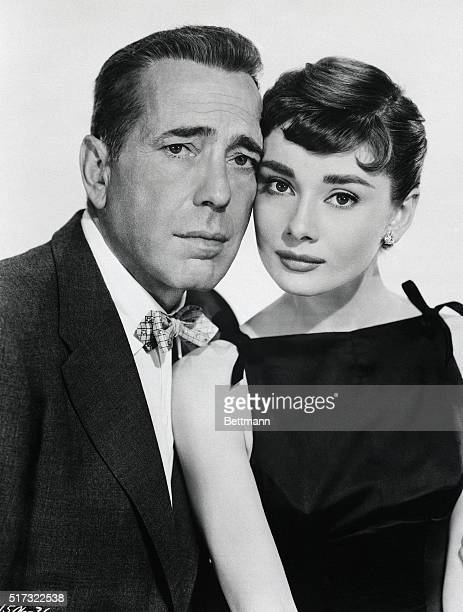 Humphrey Bogart and Audrey Hepburn appear in a publicity still for the film Sabrina, in 1954.
