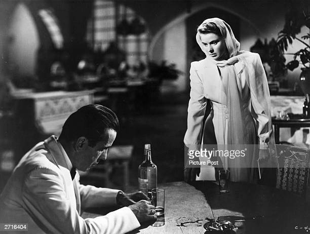 Humphrey Bogart and Ingrid Bergman in a scene from the film 'Casablanca', directed by Michael Curtiz for Warner Brothers. Original Publication:...