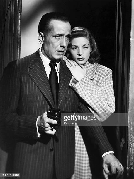 Humphrey Bogart and Lauren Bacall in a scene from the 1946 Warner Brothers film 'The Big Sleep' The couple are shown entering a room with Bogart...
