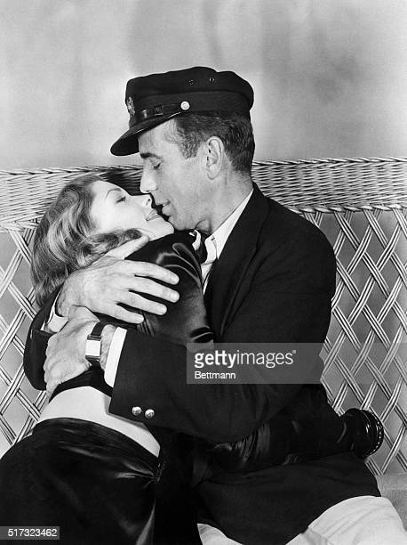 Humphrey Bogart and Lauren Bacall kiss and embrace in a scene from the film To Have and Have Not