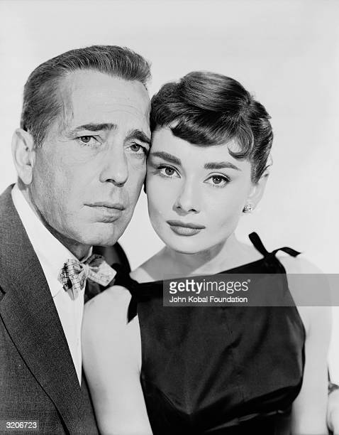 Humphrey Bogart as millionaire Linus Larrabee and Audrey Hepburn as Sabrina Fairchild the bewitching daughter of his chauffeur in 'Sabrina' directed...