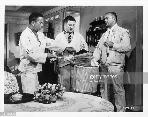Humphrey Bogart Peter Ustinov and Aldo Ray in a scene from the film 'We're No Angels' 1955