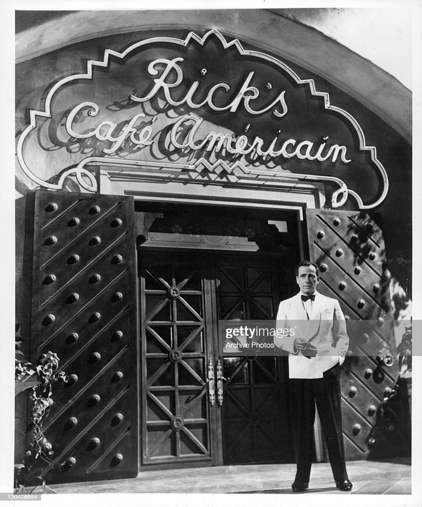 Humphrey Bogart stands outside Rick's Cafe in a scene from the film 'Casablanca', 1942.
