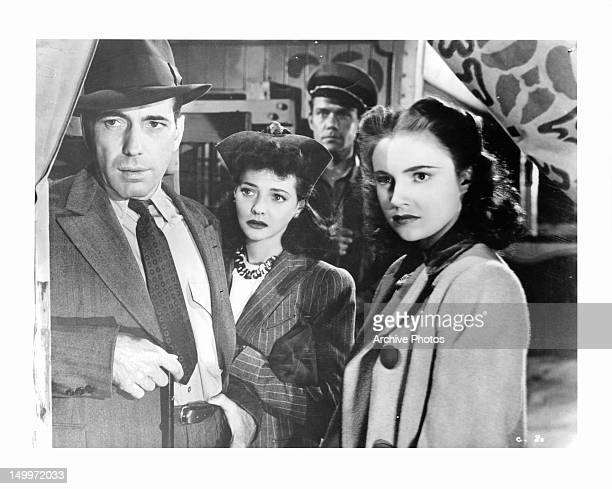 Humphrey Bogart Sylvia Sidney and Joan Leslie looking out in a scene from the film 'The Wagons Roll At Night' 1941