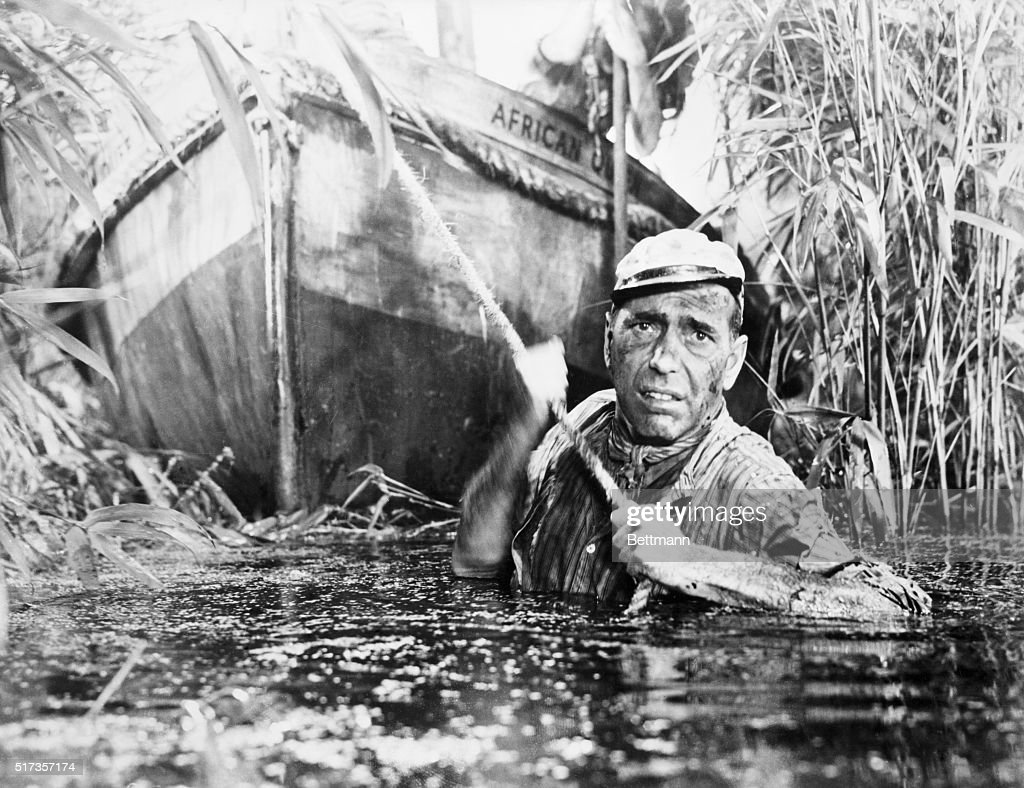Humphrey Bogart towing the African Queen through the jungle swamp in 'The African Queen.' Movie still.
