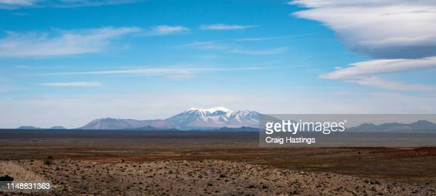 FLAGSTAFF, USA - APRIL 15, 2019: Humphreys Peak Mountain range flagstaff shot from the winslow arizona meteor crater