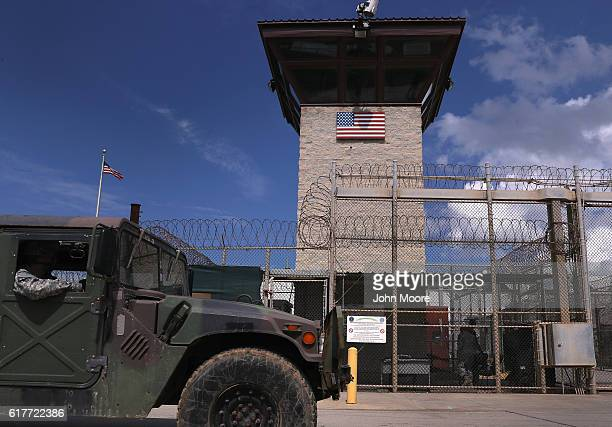 "Humvee passes the guard tower guard tower at the entrance of the U.S. Prison at Guantanamo Bay, also known as ""Gitmo"" on October 23, 2016 at the U.S...."