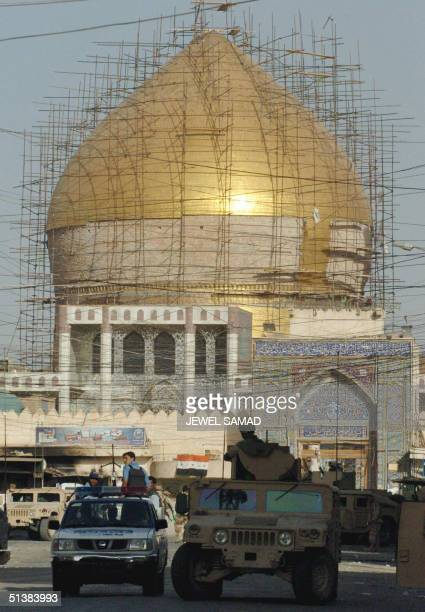 US humvee patrols past the golden mosque of Imam Hassan alAskari in Samarra 02 October 2004 The situation in this city was largely under control...