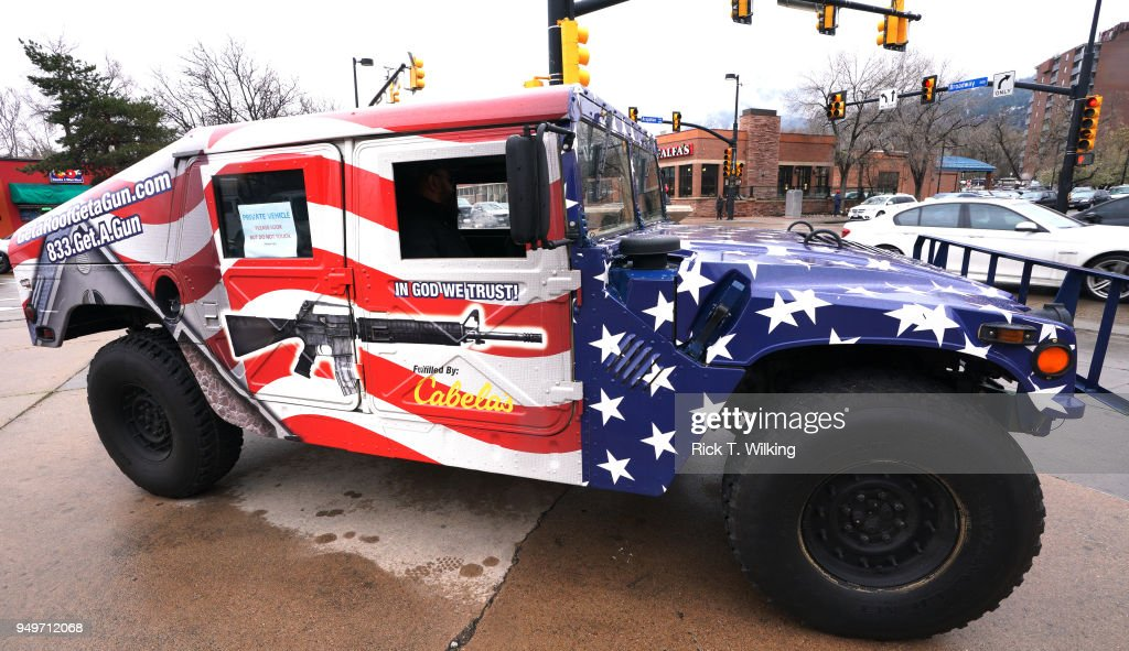 A Humvee with an American flag paint is parked at a pro gun rally on April 21, 2018 in Boulder, Colorado. The city of Boulder is considering enacting an ordinance that will ban the sale and possession of assault weapons in the city.