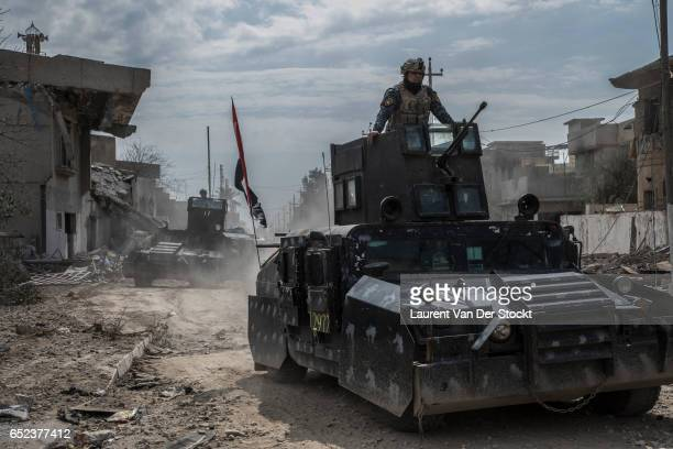 Humvees of the federal police in a district taken back from the Islamic State in western Mosul.