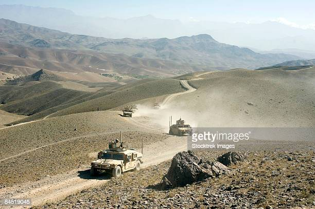 humvees traveling through roads in afghanistan. - military operations in afghanistan stock photos and pictures