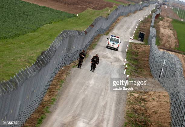 Hunagarian soldiers patrol the HungarianSerbian border on April 5 near the village of Gara Hungary Hungary will hold a parliamentary election on...
