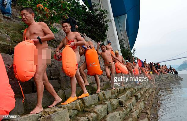 Hundereds of men celebrate the Singles' Day by taking the skinny dipping on 09th November 2014 in Chongqing SichuangChina