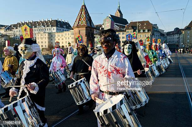 Hundred different groups of masked people walk through the streets of Basel for 3 days and nights at 'Basler Fasnet' playing music all the time