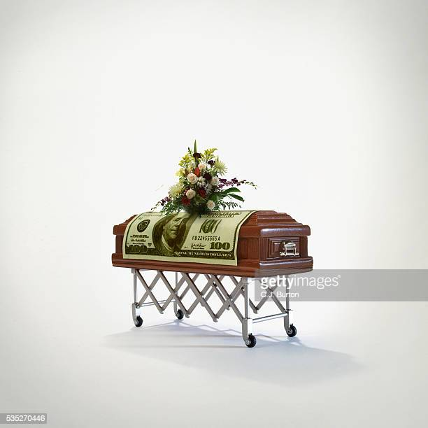 hundred dollar bill on coffin - coffin stock pictures, royalty-free photos & images