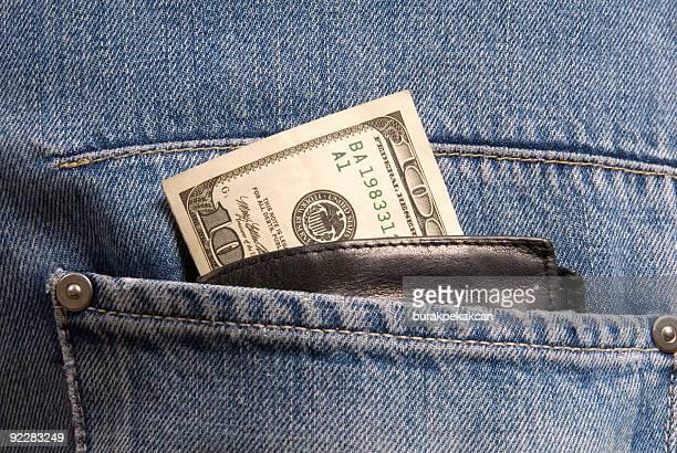 Hundred dollar bill sticks out of a wallet
