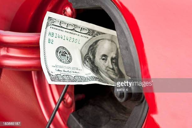 A hundred dollar bill stuffed into a cars gas tank