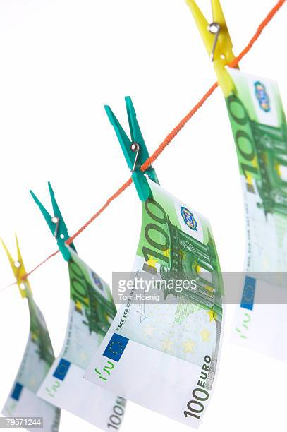 hundred euro notes on clothesline, close-up - monetary policy stock pictures, royalty-free photos & images