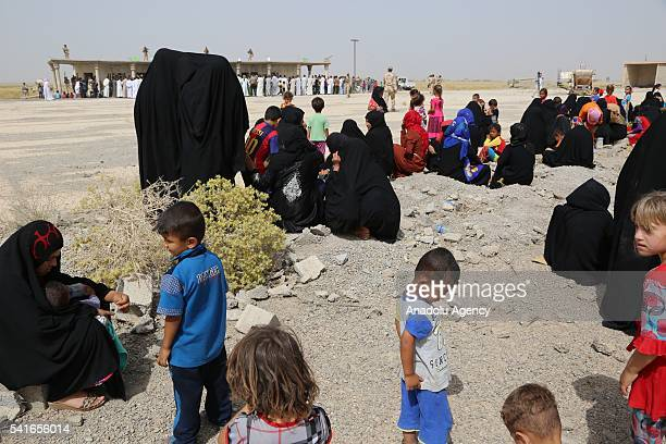 300 hundred families are seen in Diyala Iraq before they return to their houses in the Nahr Al Uzaym neighborhood after it has been recaptured from...