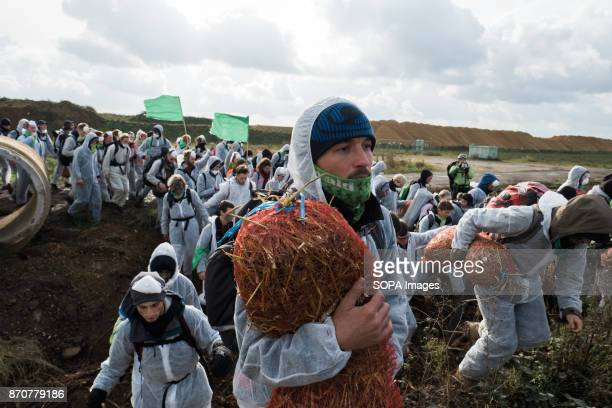Hundred of activists from the collective Ende Gelande seen walking through the mine site during a demonstration ahead of COP23 As COP 23 is about to...