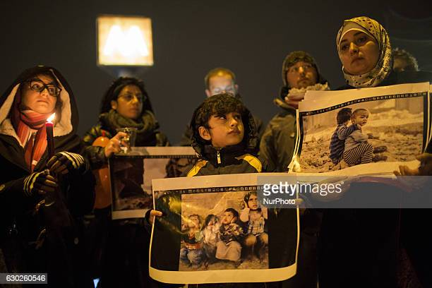 A hundred of citizens both from Syria and Italy take part in a candlelight vigil in solidarity with people living in Aleppo next to the Russian...
