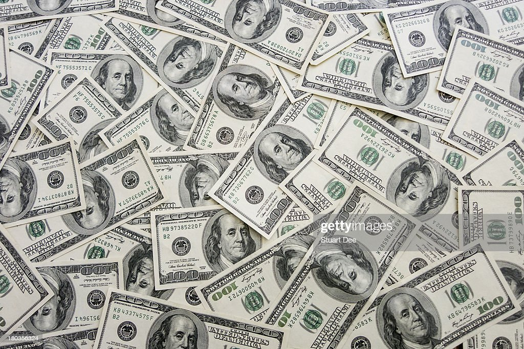 Hundred-dollar bills spread out : Stock Photo