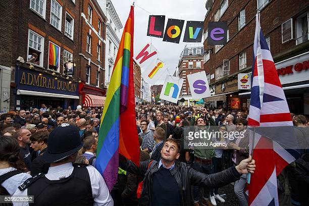 Hundreds attend a vigil for the victims of the Orlando nightclub shooting outside the Admiral Duncan pub on Old Compton Street Soho on June 13 2016...