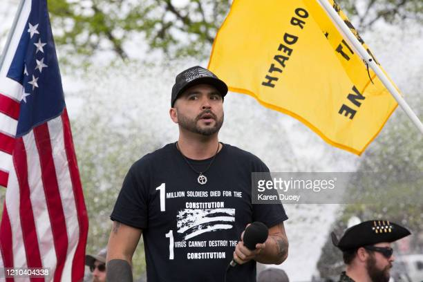 Hundreds gather at a 'Hazardous Liberty! Defend the Constitution!' rally to protest the stay-at-home order, at the Capitol building on April 19, 2020...