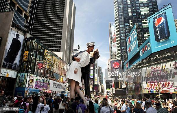 Hundreds gather in Times Square to view the sculpture at the site of the historic LIFE Magazine cover photograph of an unidentified sailor kissing...