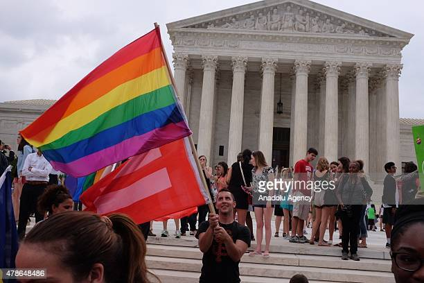 Hundreds gather outside of the Supreme Court on Friday to celebrate the decision to legalize gay marriage in all 50 states in Washington on June 26...