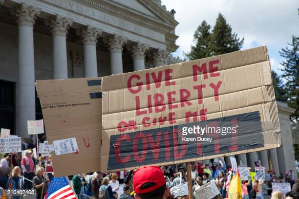 Hundreds gather to protest the state's stay-at-home order, at the Capitol building on April 19, 2020 in Olympia, Washington. Washington state Gov....
