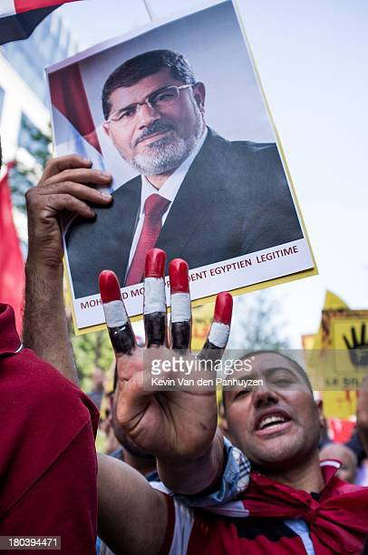 Hundreds gathered near the European Commission's headquarters to protest against the violence in Egypt. The anti-coup protesters claim that Morsi is...