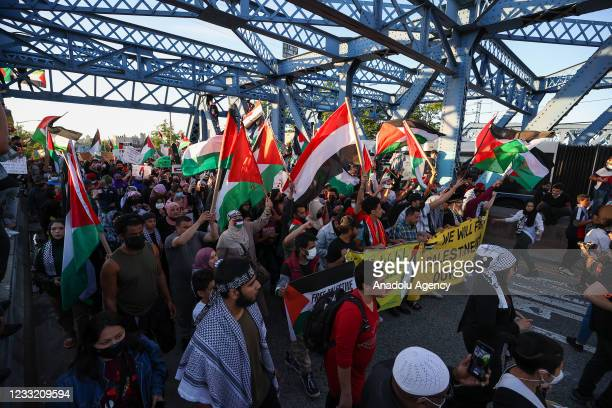Hundreds holding banners and Palestinian flags gather at the Little Yemen district of Bronx and take streets to protest Israeli aggression against...
