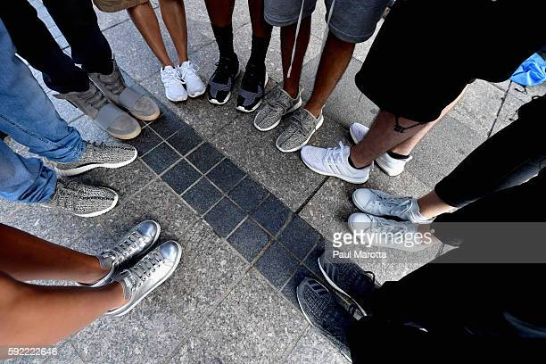 Hundreds line up many as early as 430 pm the day prior to attend the opening of the Kanye West temporary PABLO store on Boylston Street on August 19...