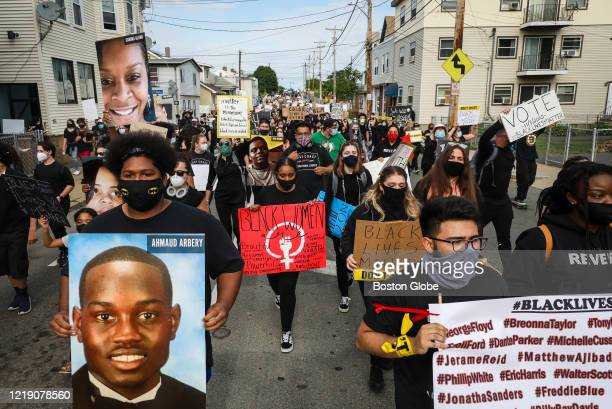 Hundreds march during a demonstration on June 9, 2020 in Revere, MA for George Floyd and other Black Americans killed at the hands of law...